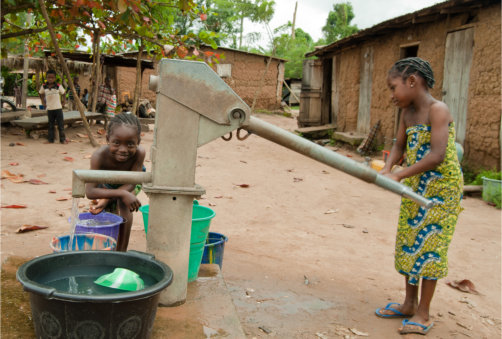 Young girl and her sister fetching water