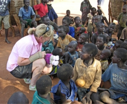 woman doing a charity work for poor children